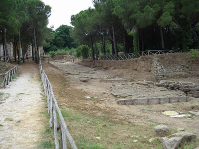 Paved Etrusacn road to the Acropolis temples Populonia, Maremma Italy