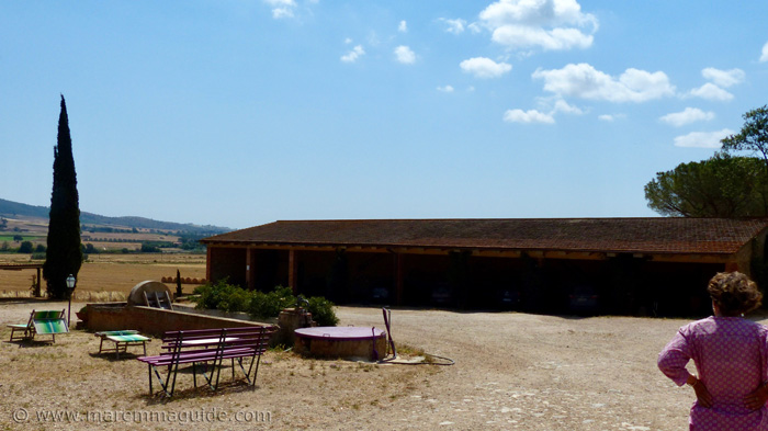 Shady barn parking for guests.