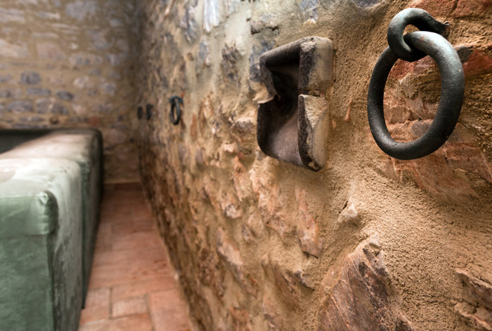 Agriturismo Alberese stone farmhouse holiday accommodation. Details of iron work in old stables and barn.
