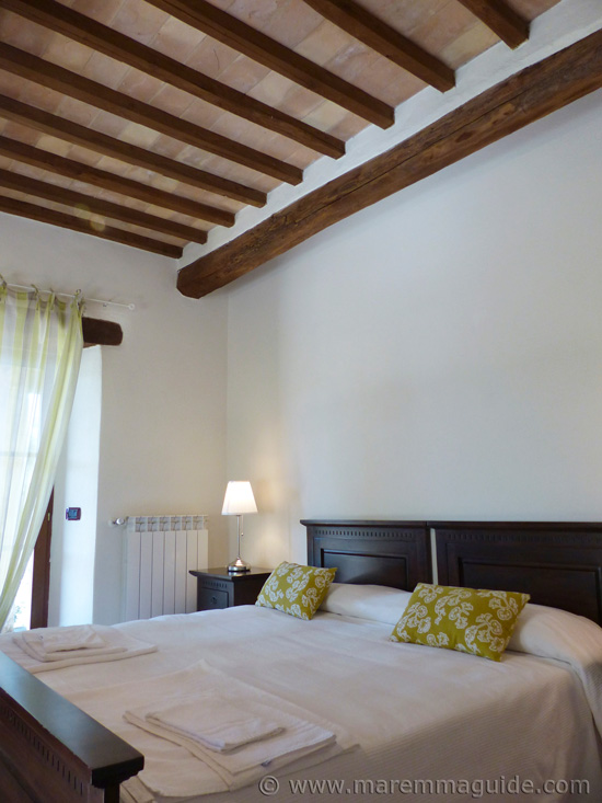 Double bedroom of apartment for sale in Tuscany.