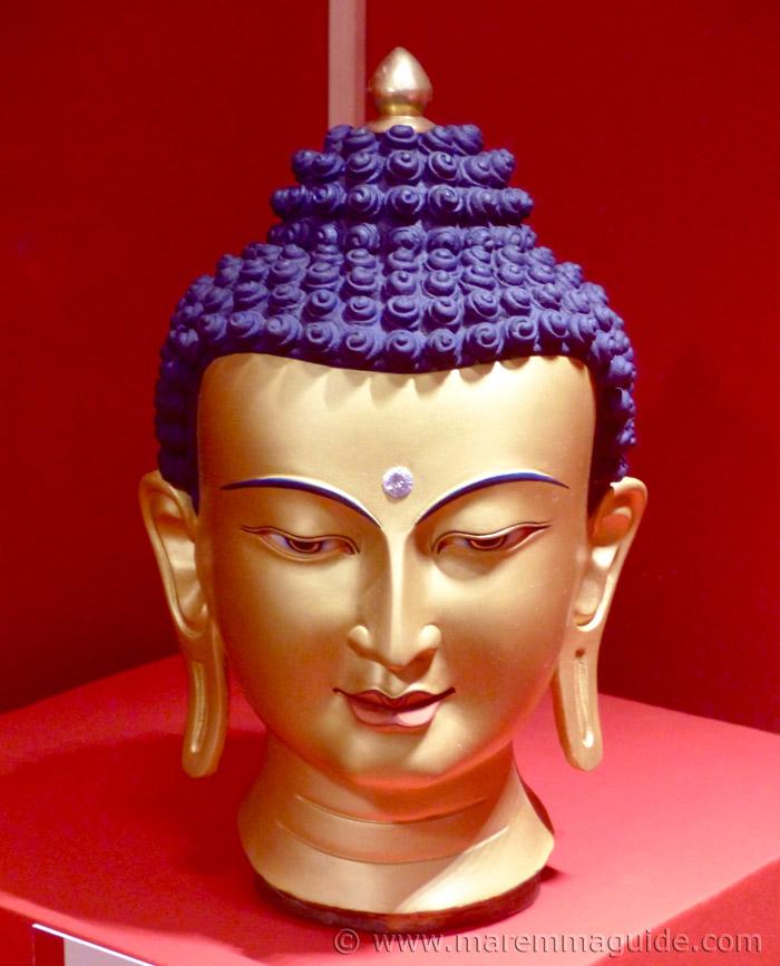 Tibetan Bhudda head in gold.
