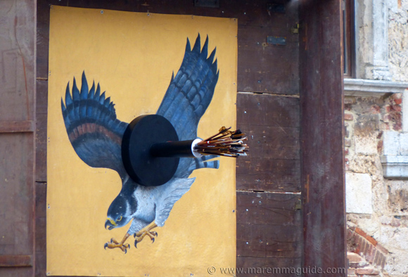The Balestro del Girifalco falcon target full of arrows just before the last shots are taken by the crossbow archers.