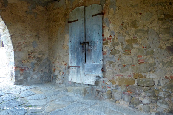 Buriano Tuscany: old door in the medieval tower gateway.