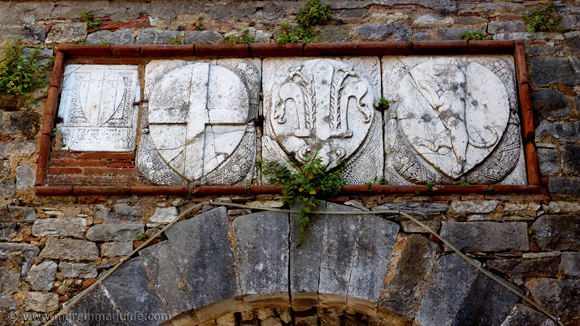 Campiglia Marittima coats of arms above the Porta a Terra