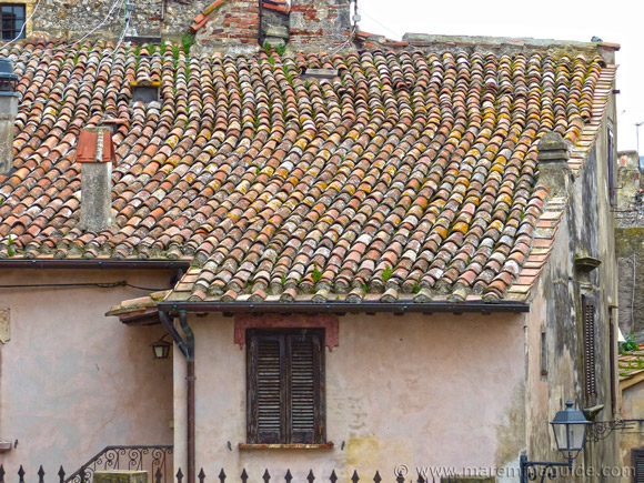 Terracotta-tiled rooftop in Capalbio.