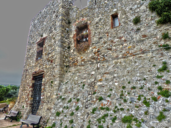 11th century buttressed city walls of Capalbio with tower.