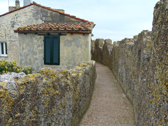Capalbio Tuscany: the medieval wall-walk and house bulit into the wall.