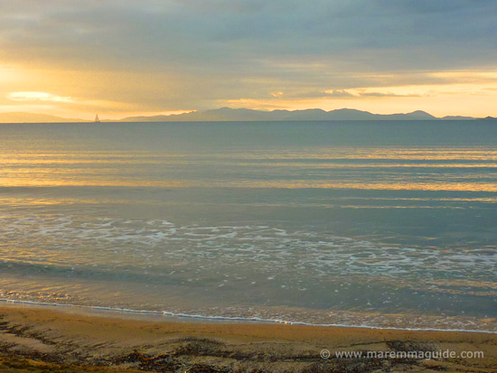 Smokey grey sunset over the Isola d'Elba from Capanna Civinini beach in Maremma Tuscany