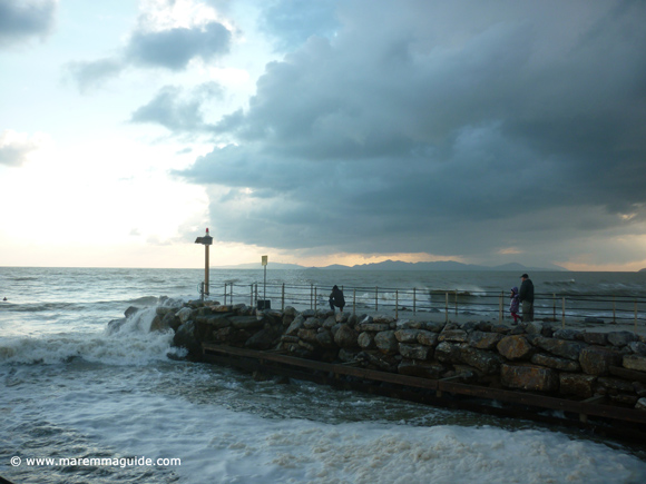Photographing sea storm waves on the jetty in February.