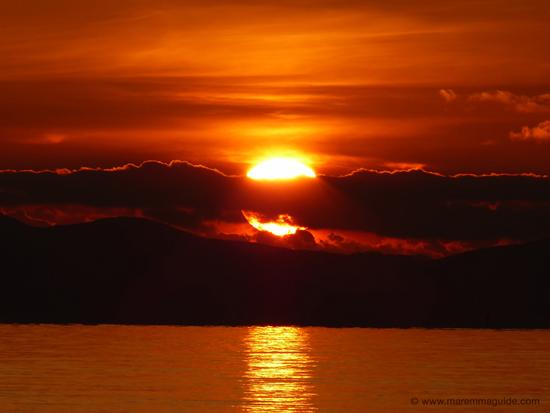 Carlappiano beach orange sunset in December, Tuscany