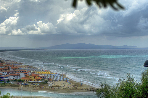 Changeable summer weather along the coast at Castiglione della Pescaia Maremma Italy