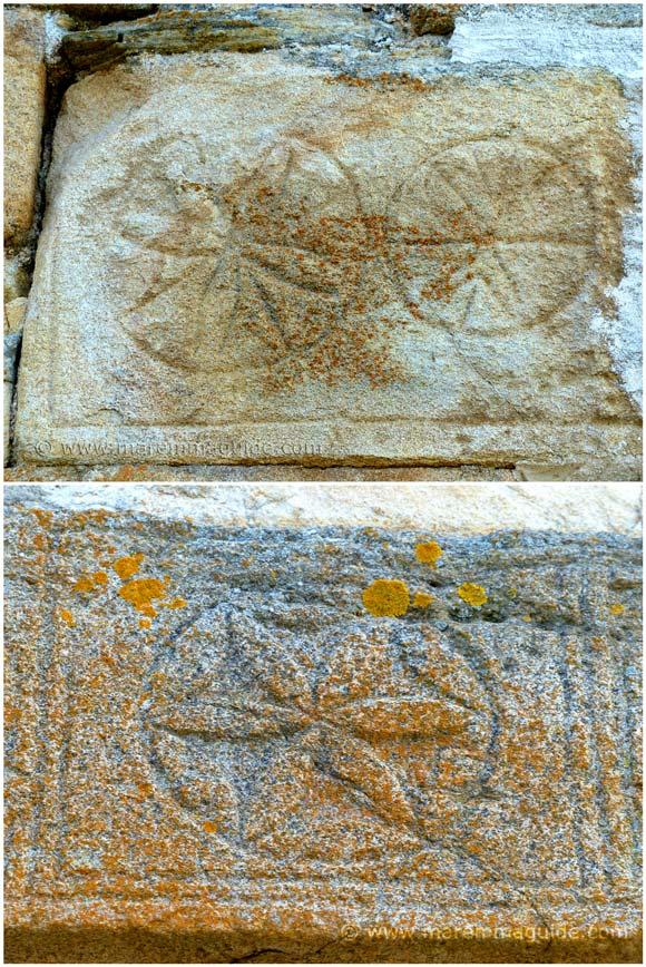 Chiesa della Santissima Concezione Sticciano carved floral and geometric stone decorations in the lintel above the front door.