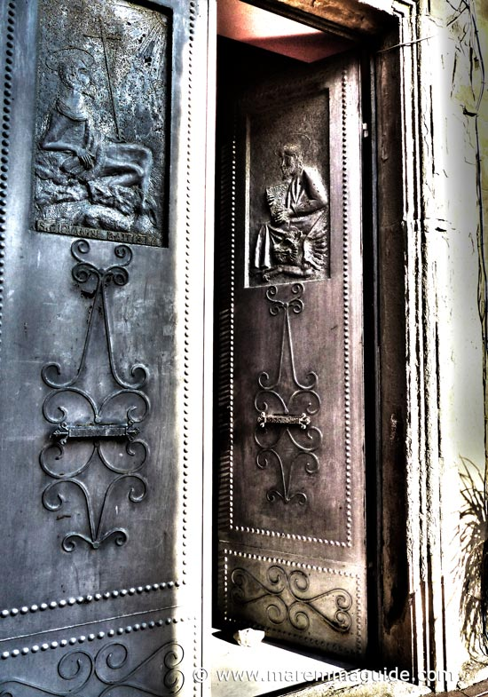 Wrought-iron door of the church of San Giovanni Battista in Pereta