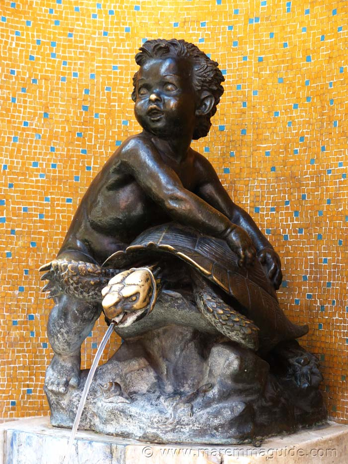 The turtle and child bronze statue in Siena of the Contrada della Tartuca.