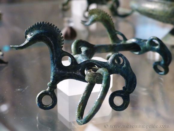 Etruscan artifacts: seahorse horse-bits foind in the tomb of a cavalry soldier.