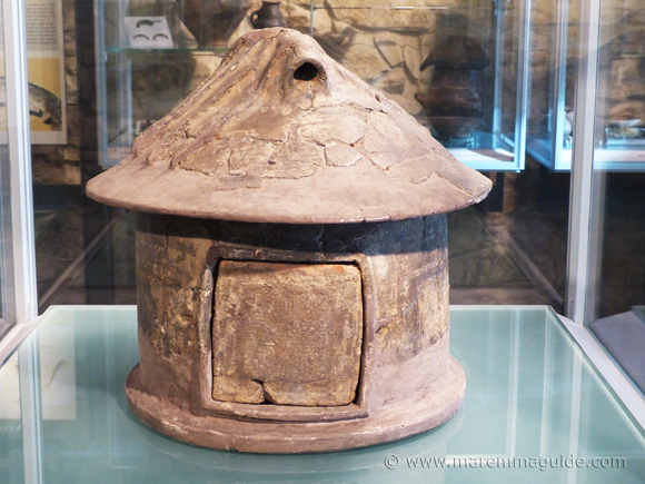 Etruscan impasto pottery: 9th century BC cinerary urn in the shape of a hut from Vetulonia.