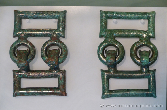Etruscan bronze horse head belt closures.
