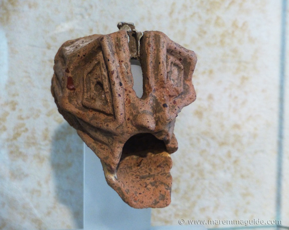 Etruscan pottery face.