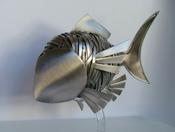 Unusual sculptures: a handcrafted fish in brass