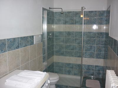 Follonica villa apartment bathroom with walk-in shower