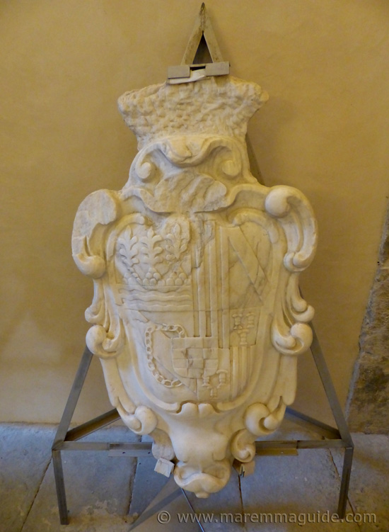 16th century Spanish royal family coat of arms in stone at Forte Stella in Porto Ercole Tuscany.