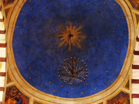 Grosseto cathedral painted cupola ceiling and chandelier.