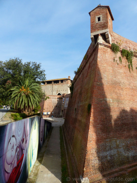 Grosseto tourist attractions: modern-day street art meets intact Medici city walls.