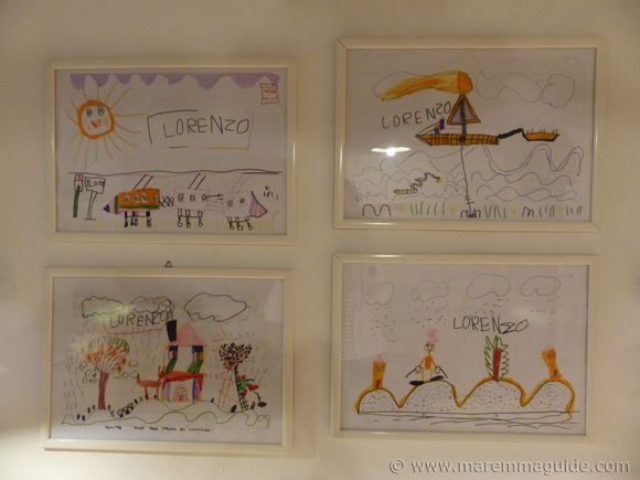 Framed child's drawings.