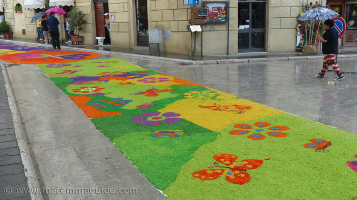 The heavens opened on the streets paved with flowers.