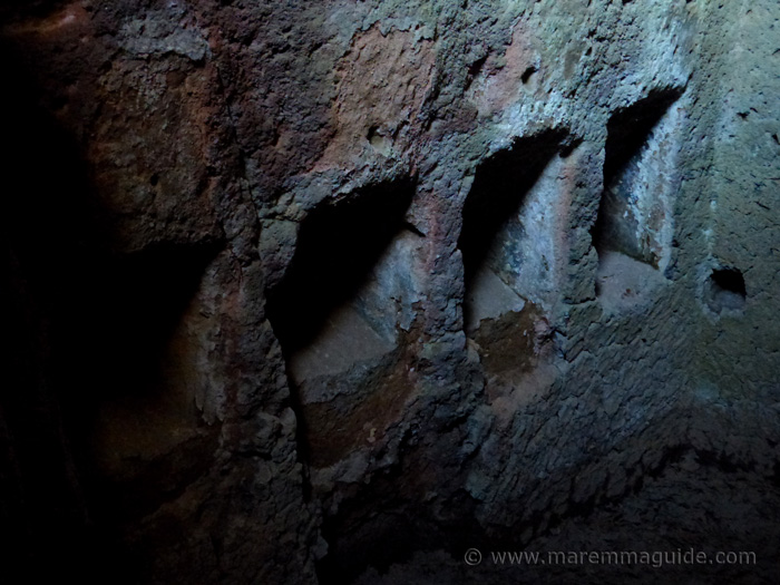 Holes in Etruscan cave dwelling wall for bed support timbers at Sorano Tuscany