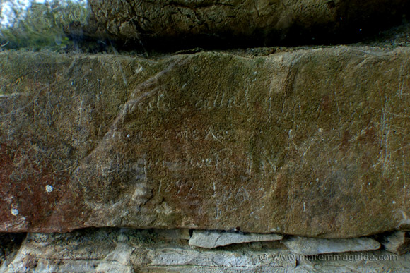 Isidoro Falchi graffiti on the wall of the Pietrera tomb Vetulonia.