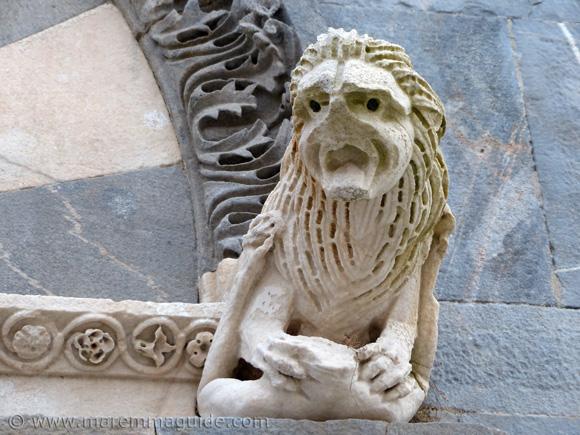 Pieve di San Giovanni: lion and human figure statue Campiglia Marittima