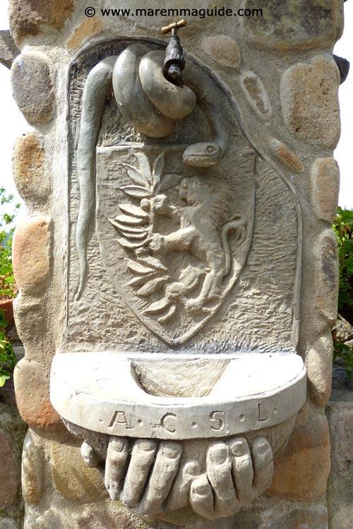 Lustignano snake water fountain detail