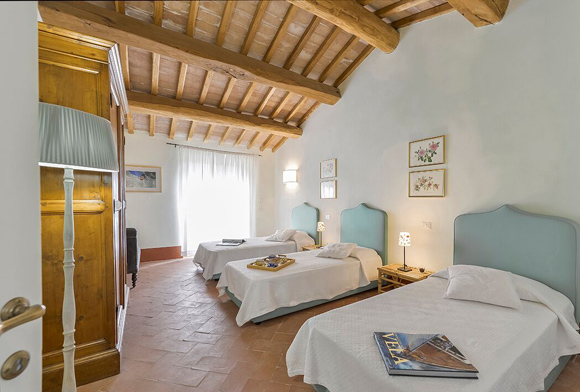 Luxury Maremma holiday villa bedroom.
