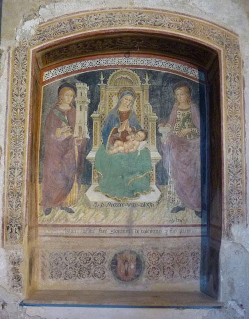 Madonna Enthroned with Child and Saints Barbara and Lucia fresco: early Renaissance school of Andrea di Niccolo, Sovana Maremma Tuscany Italy