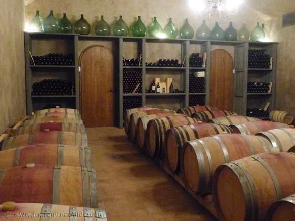 Maremma winery cellar with oak barrels