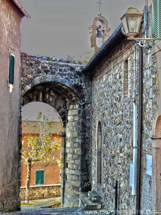 Porta di Sant'Elena and the castle chapel of Saint Rocco and Saint Elena in Montegiovi.