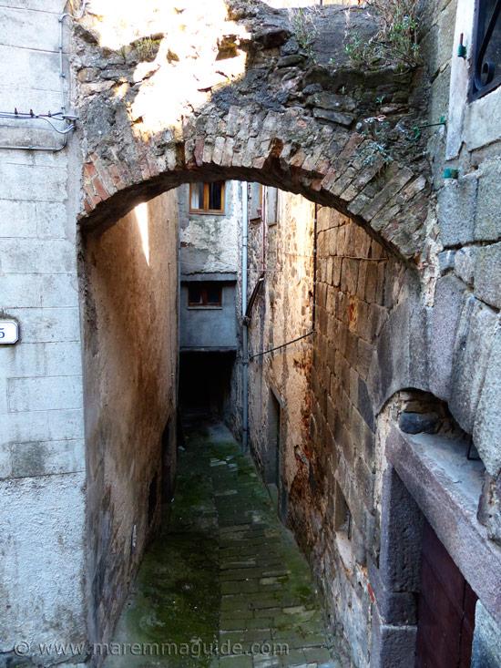 Dank dark alleyway in Montelaterone Tuscany
