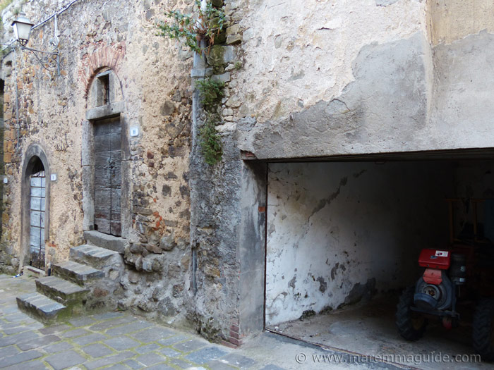 Old Tuscany doors and garage with tractor in Montelaterone