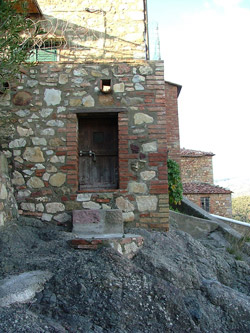 Tiny doorway in a building in Montemassi, Roccastrada, Maremma