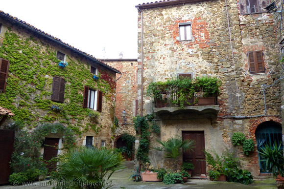 Small enclosed piazza within he Castello di Montemerano Tuscany Italy