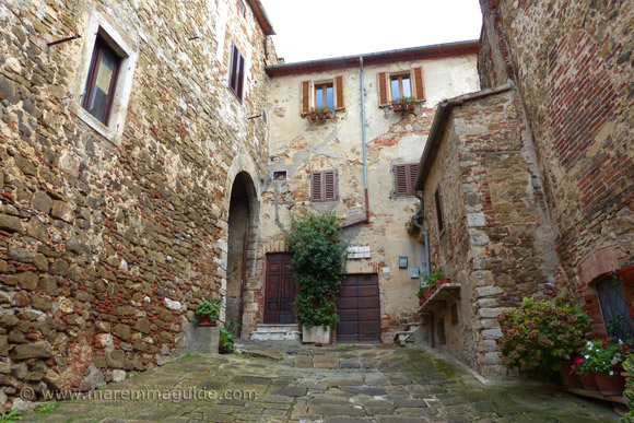 Street entrance to Montemerano castle Tuscany