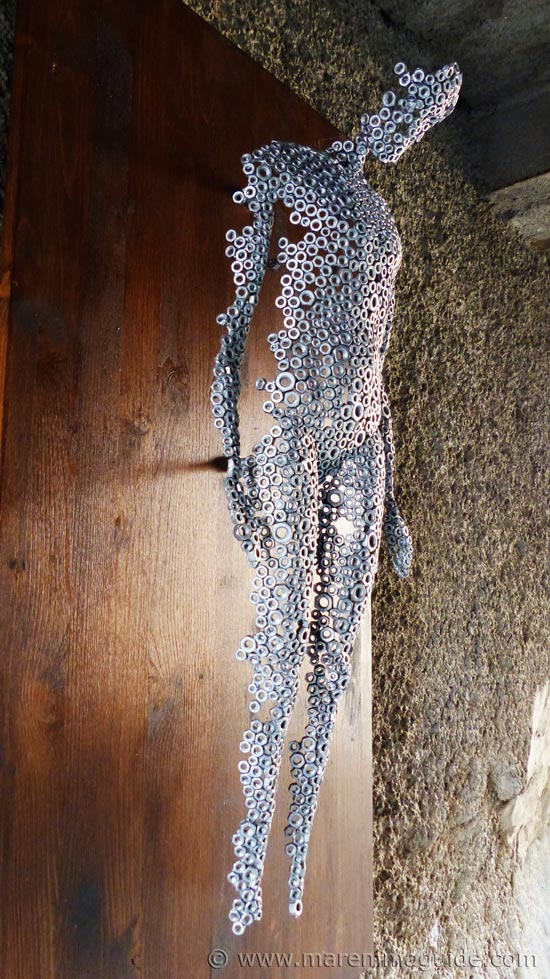 Recycled metal art: human figure made of nuts. The Mostra La Rocca Roccatederighi.