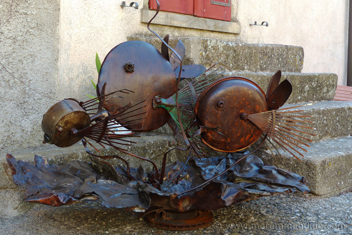 Metal art fish in Roccatederighi outdoor exhibition.