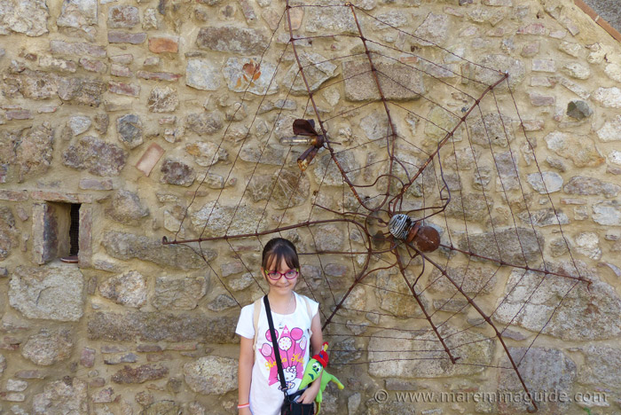 Metal art spider web and fly.
