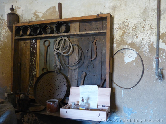 Antique eqipment for the production of extra virgin olive oil in Seggiano.