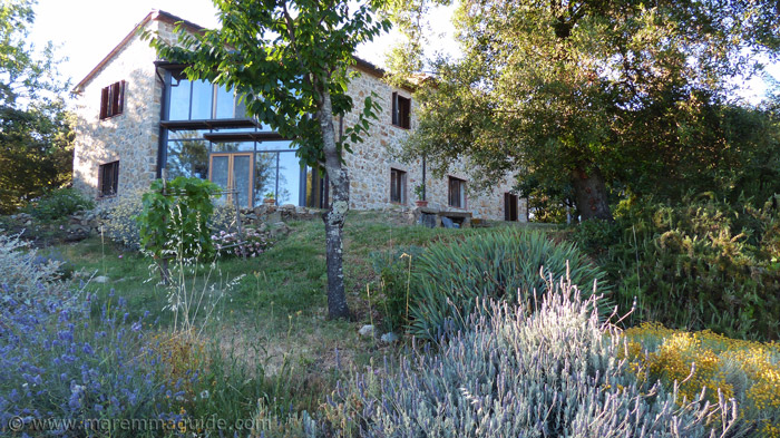 Restored Tuscany farmhouse for sale with views.