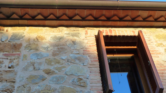 Restored Tuscany farmhouse: late evening sun on the eaves