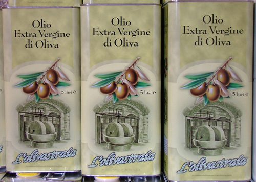 Tins of cold press olive oil