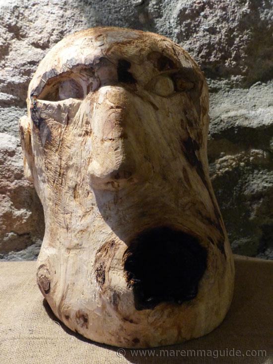 Olive wood human head.